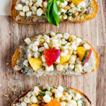 Corn + Peach Crostini with White Bean Basil Puree