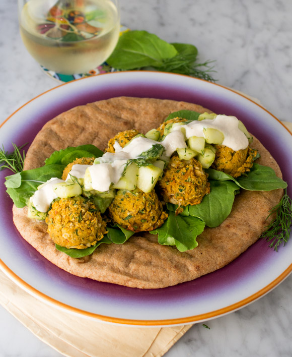 Sweet Potato Falafel Sandwich with cucumber avocado salad and lemon tahini sauce